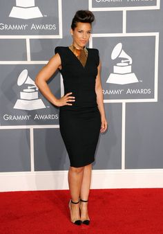 Alicia Keys looked sleek and sophisticated in a black Alexandre Vauthier dress with strong shoulders. She accessorized with Christian Louboutin Bis un Bout pumps, and an Amrapali collar necklace and cuff.  Grammys 2012