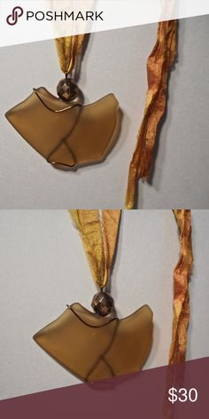 """golden brown vintage glass art pendant Rich golden brown vintage glass, wrapped in bronze plated wire, and adorned with a large, faceted bronze glass bead. Measures 2""""h x 2 1/2""""w, and on a golden orange silk sari ribbon klinsky Jewelry Necklaces"""
