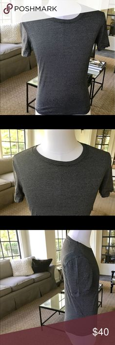 Burberry Men's Seersucker Stripe Short Sleeve Tee Not brand new but appears to have never been worn is an Authentic Men's Burberry Tee.  Just a note this tee is not a loose fitting tee. This tee is black with a very fine white seersucker Stripe, roundneckline, straight hem and 100% Cotton Burberry Shirts Tees - Short Sleeve