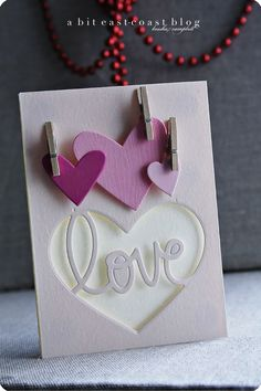 hand crafted balentine .. clean lines from die cutting hearts ... shades of purple ... cute mini clothespins ... great card!