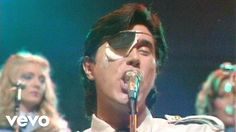 Bubbles and Bryan Ferry with an eye patch. What else do you need? Roxy Music - Love Is The Drug
