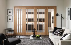 Glazed room dividers for wide doorways. These Oak Worcester style doors are configured with two matching side light panels to suit a none standard doorway.