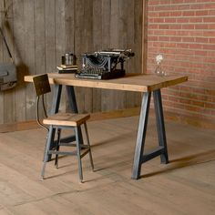 Bring a bit of Old America into your home with this wooden desk! Reclaimed from century-old American buildings, the wood has been refinished but still retains the character-rich nicks and minor imperfections that keep its rustic charm in full force.