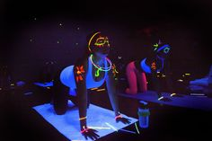 Looking to mix up your yoga routine? Try blacklight yoga with body paint! #NextLevelWorkouts
