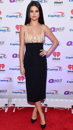 Selena Gomez  |  Selena Gomez struck a pose at the Jingle Ball Tour in a nude-and-black crystal-embroidered David Koma pencil dress with black satin pumps.
