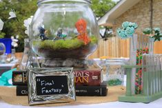 These guys made geeky terrarium  centerpieces... each one was different. This is the Final Fantasy table!