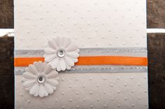 Pretty white wedding invitation with orange satin ribbon detail with two white daisies with diamante centers. Lily Wedding, Daisies, Enchanted, Wedding Invitations, Stationery, Ribbon, Satin, Orange, Detail