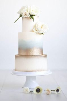 Icy Elegance - Watercolor Wedding Cakes Might Be the Next Big Wedding Trend - Southernliving. If you're looking for a simple, yet stylish design with a small pop of something blue, we've found it. This color palette would fit perfectly in a spring or winter wedding. Click here to see the pin. #smallweddingcakessimple