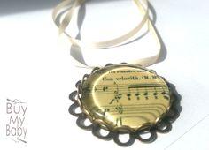 """Kollektion """"Musik"""" Halskette No2 Con velocità Motiv gedruckt auf hochwertigem Glanzpapier,  versiegelt und mit einem Glasstein geschlossen.  D..."""