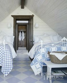 Attic bedroom with quilts via Hydrangea Hill Cottage and BHG