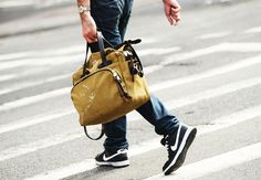 New York Fashion Week: Denim, nicely worn khaki holdall, slick, black Nikes. I really like the Nikes; I just can't love 'em 'cause they don't last as long as how good they look.