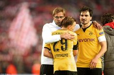 Klopp (left) commiserates Marcel Schmelzer (centre) and Mats Hummels at full-time - two players he used to manage at Dortmund