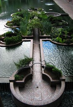 Sunken watergarden in the middle of the Barbican development, London opened 1982. The Barbican Centre is a performing arts centre in the City of London and the largest of its kind in Europe. The Centre hosts classical and contemporary music concerts, theatre performances, film screenings and art exhibitions. It also houses a library, three restaurants, and a conservatory. #gardeninginthecity