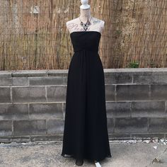 "Black Formal Maxi Dress with Shirred Bust size 8 Black Formal Maxi Dress with Shirred Bust size 8 bust measures 30"", waist is 28"" and length is 50"" from bust to hem. Mint condition no snags rips or stains. Worn once . Vineyard Collection Dresses Maxi"
