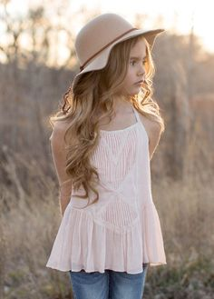 This adorable and comfortable tank features a lovely blush hue and beautiful pin-tuck embellishments on the front.