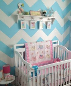 Blue and white chevron nursery with pink accents and elephants. Adorable!