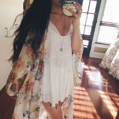 Short white lace dress, floral kaftan, and chunky cork wedges.