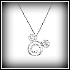 """I LOVEEE!  Mickey's image is formed here from 3 diamond-encrusted swirls on this dazzling necklace with a platinum setting. Hanging from a fine platinum rope chain with a lobster claw clasp, this necklace features 1.04 carats total weight of diamonds and is 1 1/8""""  in diameter.  This piece is part of the Disney Dream Collection, which guarantees that every diamond will be to be no less than G-H in color and SI-1 in quality. This fantastic sparkler will run you $6,625 before taxes and…"""