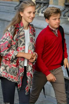 The teenage Princess Elisabeth and Prince Gabriel were relatively casually dressed for their first day back at school after the summer holidays