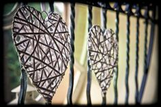 Love hearts decorating the entrance gate of the Church. Photographed by Jinx Photography.  www.JinxPhotography.co.uk