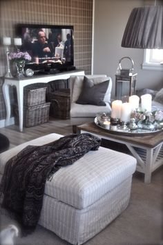 I like the idea of the tv stand on a table like that. Not crazy about everything being gray
