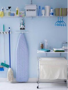 Don't fret, look up. Utilizing the entire wall for vertical storage, allows you to maximize a small laundry space. Inexpensive fixtures can be purchased at a home improvement store. Organisation Hacks, Laundry Room Organization, Laundry Room Design, Laundry Sorter, Organization Station, Laundry Storage, Wall Storage, Laundry Basket, Storage Ideas