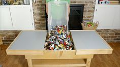 A DIY table might be the solution to keeping your #LEGOs organized. http://www.popularmechanics.com/home/how-to-plans/how-to/a20182/diy-sliding-lego-table/