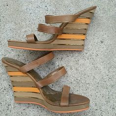 """Wedge sandal brown leather with orange accent Beautiful light weight sandal. . Heel is 4.5"""" height. . Brown and orange. . Inside lining is leather as well.. very cute perfect for summer.. bottom is rubber for firm grip.. brand name is greater la but has no tag or box.. paid $125plus tax.. no defects,  no scuffs or scratches. . No trades Shoes Sandals"""