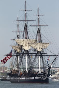 ~The USS Constitution is escorted by a tugboat in Boston Harbor in Boston, Sunday, Aug. 19, 2012. The USS Constitution, the U.S. Navy's oldest commissioned war ship, sailed under her own power during the event Sunday for the first time since 1997. The sail was held to commemorate the 200th anniversary of the ship's victory over HMS Guerriere in the War of 1812. (AP Photo/Steven Senne)~
