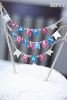 Mother's Day Party DIY Decor: http://savvystyle.net/2013/05/13/mothers-day-party-diy-decor/  mothers-day-cake-bunting-2