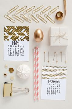 Shiny and sassy gold foiled calendar. The patterns, words and numbers are all hand-drawn and letterpressed. The calendar even comes with a cute wood stump for display! | @1canoe2