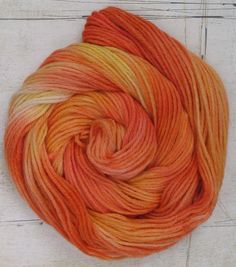check out StarAthena's tutorials on dyeing wool with koolaid or Wilton icing gel colors