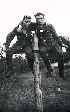 German soldiers sitting on the bar pillar. Repeat this trick are life-threatening. Help ...  Shoot us out of here.
