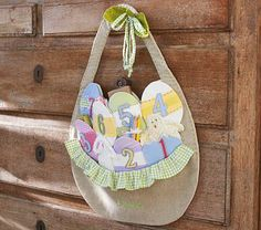 Easter Countdown Calendar #PotteryBarnKids    Behind the numbers are pockets for placing notes or treats.