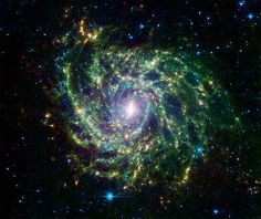 Looking like a spider's web swirled into a spiral, galaxy IC 342 presents its delicate pattern of dust in this infrared light image from NASA's Spitzer Space Telescope. The very center glows especially brightly in the infrared. Hubble Pictures, Hubble Images, Cosmos, Cosmic Web, Spitzer Space Telescope, Space And Astronomy, Nasa Space, Spiral Galaxy, Star Formation