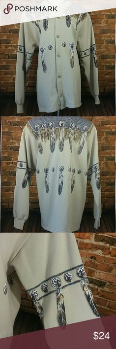 "Native American Jacket Conchos, Feathers & Beads are printed on this comfy sweatshirt style Western coat. Buttons down the front with slash pockets on each side.  Shoulder pads. Small pen mark on lower left sleeve.  23 "" across chest lying flat, 32 "" long  80 % Cotton / 20 % Polyester Art Unlimited  Jackets & Coats"