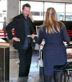 First class: The talented star never stopped talking on his phone while interacting with the airline personnel