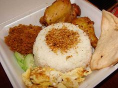 rice uduk ( combination of rice, kerupuk, chicken, abon, egg and a sprinkling of fried onions )