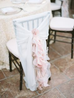 Blush chair covers | Read More: http://www.stylemepretty.com/california-weddings/2014/06/26/elegant-santa-barbara-wedding-at-bacara-resort/ | Photography: Michael Anna Costa Photography - michaelandannacosta.com