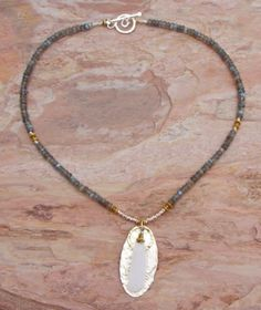 (http://www.elizabethplumbjewelry.com/white-drusy-and-labradorite-necklace/)