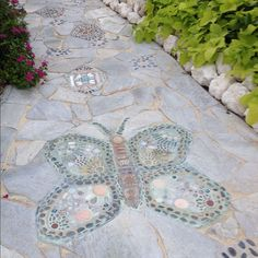 Mosaic pathway I designed for a client. Made sixteen stepping stone and the large butterfly.