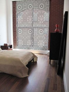 """A bedroom using Delia Shades' new """"Marrakesh Stars"""" pattern. Get a free estimate for your own project at http://www.deliashades.com/quote.php #DeliaShades #PictureWindow #MarrakeshStars #Moorish #WindowTreatments #RollerShades #RollerBlinds #SolarShades"""