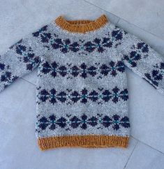 This is a soft, warm and cozy sweater suitable for both boys and girls. A rapid knit project with thick yarn and needles!
