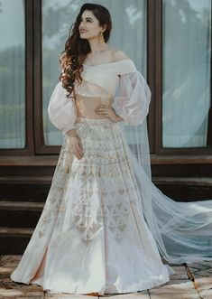 Powder pink raw silk lehenga with crepe blouse with ruching and organza balloon sleeves only on Kalki Indian Gowns Dresses, Indian Fashion Dresses, Indian Designer Outfits, Designer Dresses, Wrap Dresses, Designer Wear, Designer Bridal Lehenga, Indian Bridal Outfits, Fancy Blouse Designs
