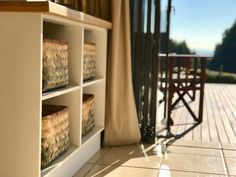 A great storage solution is using baskets. They are super stylish and provide warmth in a space. These natural baskets with a touch of blue, add colour and help organise all sorts of items.
