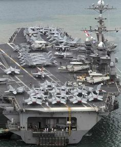 USS George Washington, a nuclear-powered 97,000-ton aircraft carrier of the U.S. 7th fleet, arrives at a navy port of South Korea in Busan, about 420 km (262 miles) southeast of Seoul June 27, 2012.