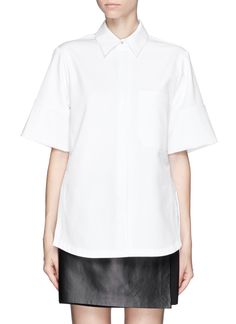 Encompass a boyfriend look with this oversized short-sleeved Proenza Schouler shirt. A combination of downtown cool and clean lines, this piece can be teamed with a black skirt and flats for a New York look.