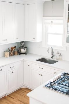 A large rectangle with tight 90-degree corners and a simple, clean-looking faucet that pulls out, has a hidden sprayer button, and snaps back into place magnetically.