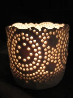 Tea light holder... make a pinch pot them make holes with a straw.