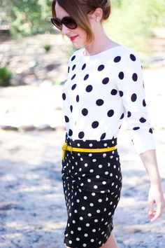 Professional outfit that works well in a corporate office or a creative office: Polka dot sweater and pencil skirt with a yellow belt.